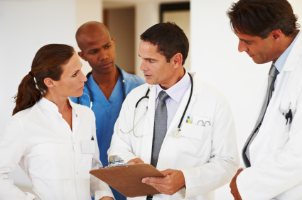 Portrait of multi racial medical team having discussion with each other