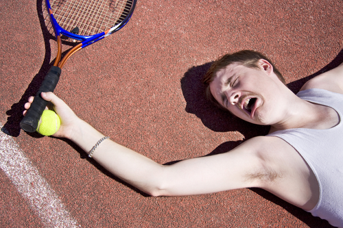 Clay Court Tennis Player Cries Out For Medical Attention With An Injured Elbow
